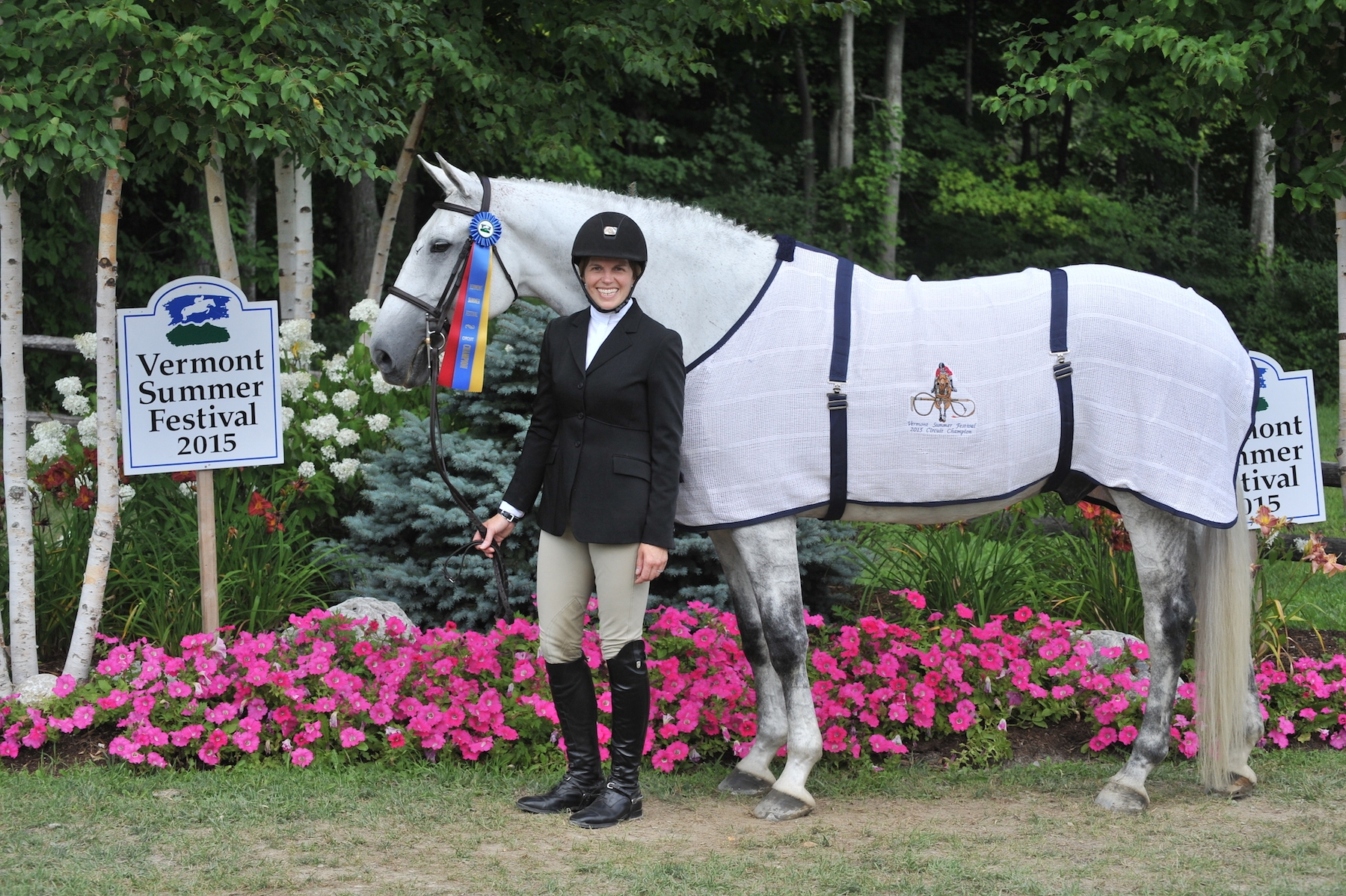 Hallie Brooks and Nick O' Time are presented as the Circuit Champion in the Adult Equitation division at the 2015 Vermont Summer Festival.<br><b>Photo by <a href='http://www.photoreflect.com/home/default.aspx' target='_blank'>David Mullinix Photography</a></b>