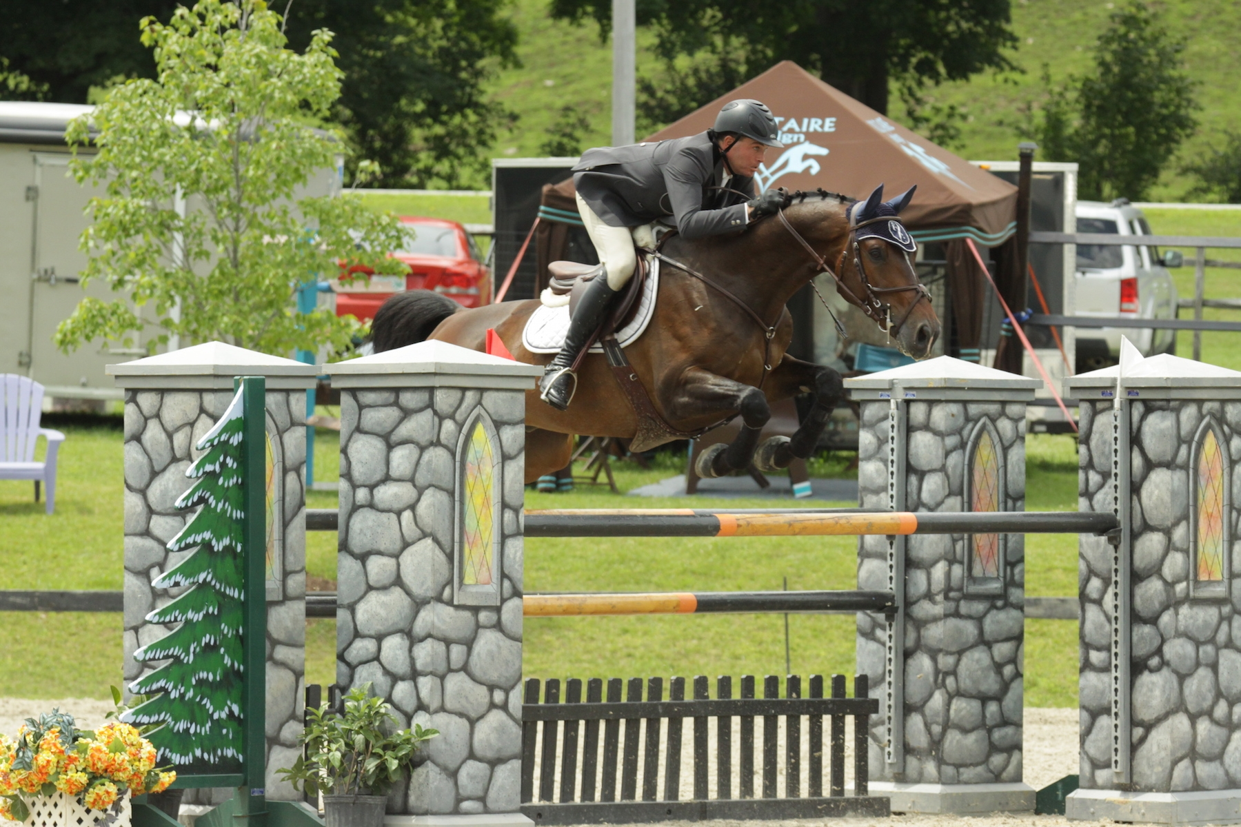 Cory Hardy and Camelot 105 on their way to victory in the $5,000 1.40m Open Jumper on July 22 at the Vermont Summer Festival in East Dorset, VT.<br><b>Photo by <a href='http://www.photoreflect.com/home/default.aspx' target='_blank'>David Mullinix Photography</a></b>