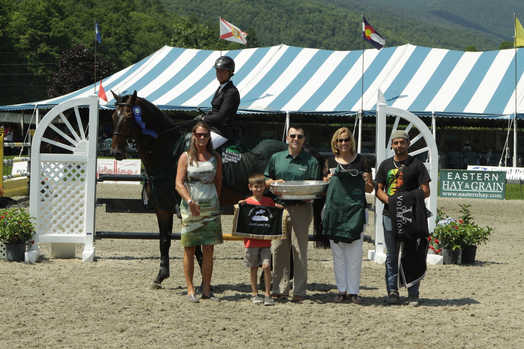 Following their win in the $30,000 Battenkill Grand Prix, presented by The Inns at Equinox, Amanda Flint, VDL Wittinger and groom Juan Pacheco, are honored by Gerry McFarland and son Kelan representing The Inns at Equinox, and Jennifer Glass and Ruth Lacey of the Vermont Summer Festival.<br><b>Photo by <a href='http://www.photoreflect.com/home/default.aspx' target='_blank'>David Mullinix Photography</a></b>