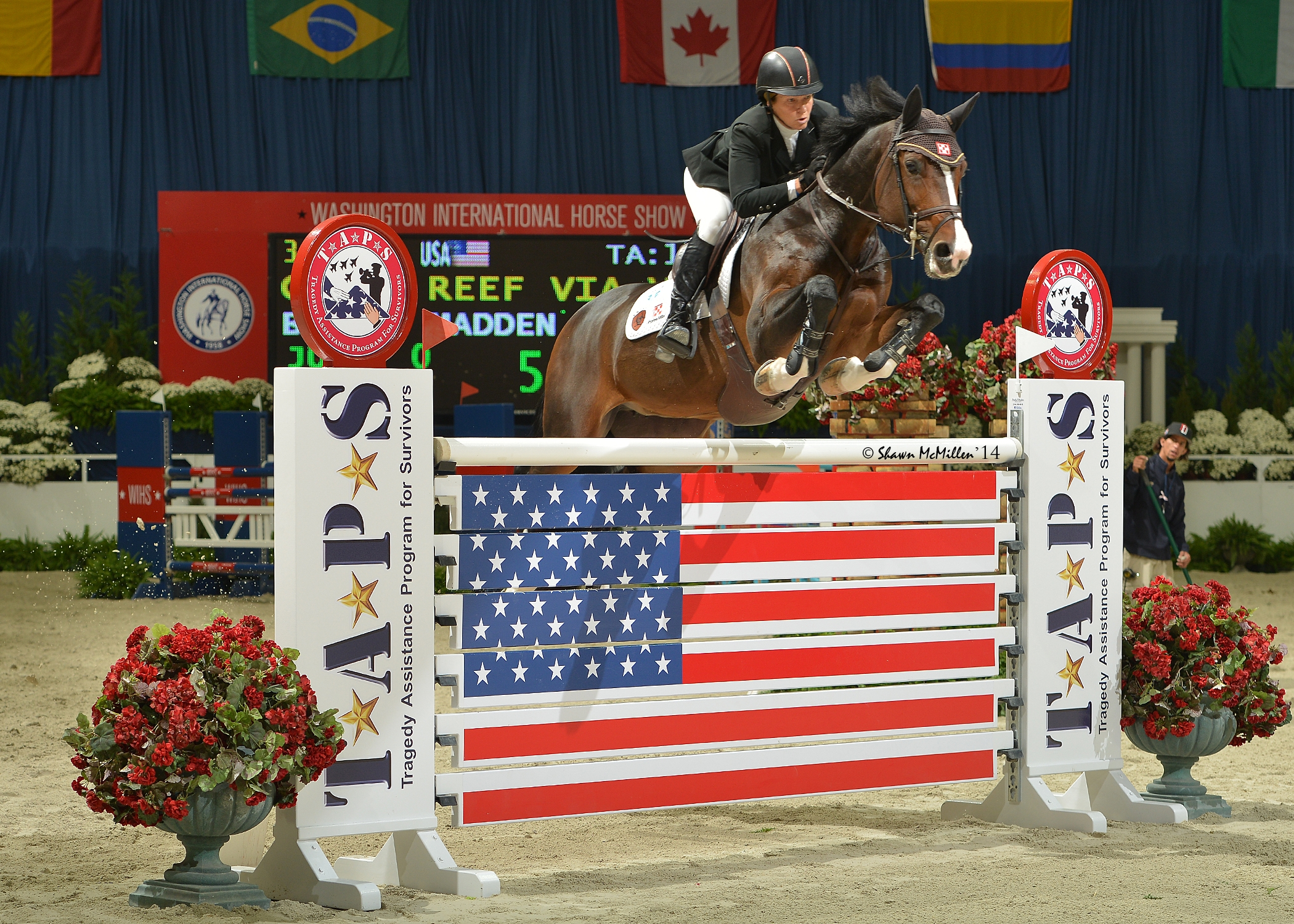 Beezie Madden and Coral Reef Via Volo clearing the Jump for TAPS Challenge fence at the 2014 WIHS. <br><b>Photo by <a href='http://www.shawnmcmillen.com/' target='_blank'>Shawn McMillen Photography</a></b>