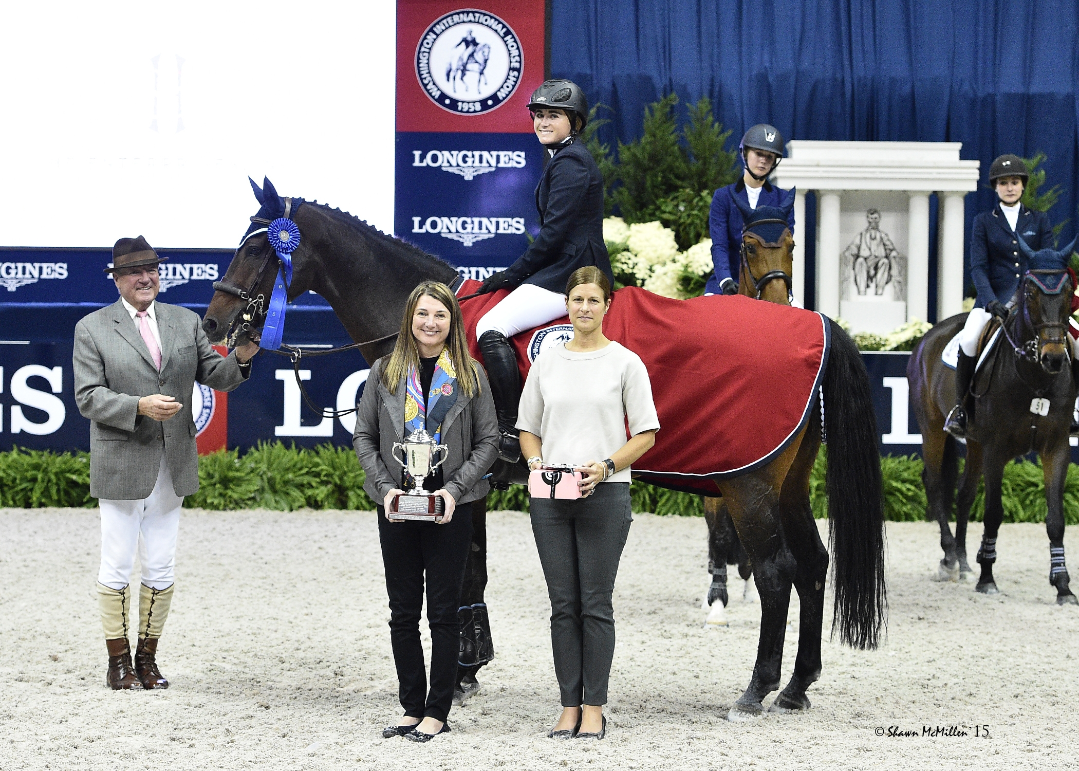 Victoria Colvin and Cafino in their winning presentation with ringmaster John Franzreb, WIHS President Victoria Lowell, and WIHS Executive Director Bridget Love Meehan. <br><b>Photo by <a href='http://www.shawnmcmillen.com/' target='_blank'>Shawn McMillen Photography</a></b>