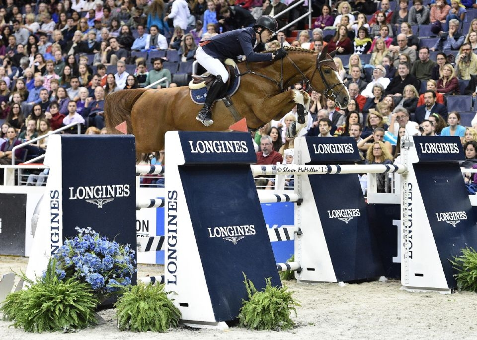 Harrie Smolders and Emerald on their way to a win in the $125,000 Longines FEI World Cup™ Jumping Washington, presented by Events DC, for the President's Cup.<br><b>Photo by <a href='http://www.shawnmcmillen.com/' target='_blank'>Shawn McMillen Photography</a></b>