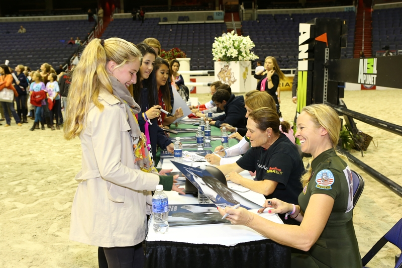 At the end of the show, Barn Night attendees line up for autographs from top riders.  Photo courtesy of WIHS