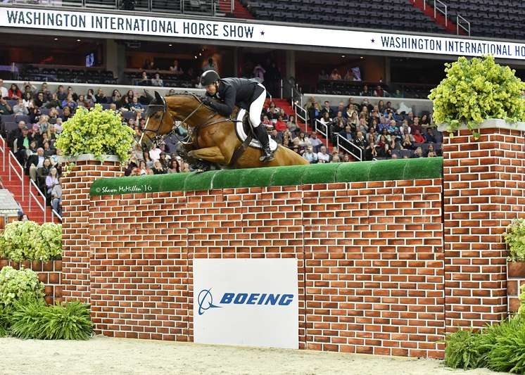 McLain Ward (USA), currently ranked the #2 rider in the world, and ZZ Top VS Schaarbroek Z cleared 7' to tie for first with Aaron Vale and Finou 4 in the 2016 Puissance, presented by The Boeing Company. <br><b>Photo by <a href='http://www.shawnmcmillen.com/' target='_blank'>Shawn McMillen Photography</a></b>