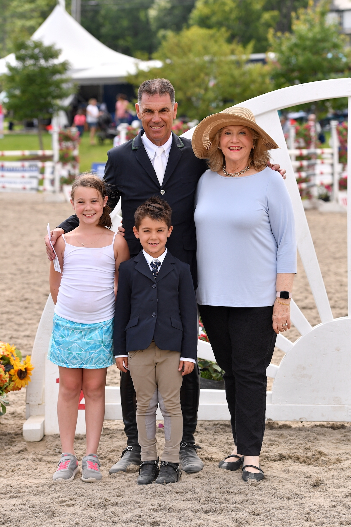 Jimmy Torano (center) is presented as winner of the $10,000 Sir Ruly, Inc. Open Jumper Awards by, from left to right, his daughter, Natalia, son, JJ, and Ruly Torano's wife, Maria Teresa Torano, at the 2017 Vermont Summer Festival at Harold Beebe Farm in East Dorset, VT.<br><b>Photo by <a href='http://www.andrewryback.com/' target='_blank'>Andrew Ryback Photography</a></b>