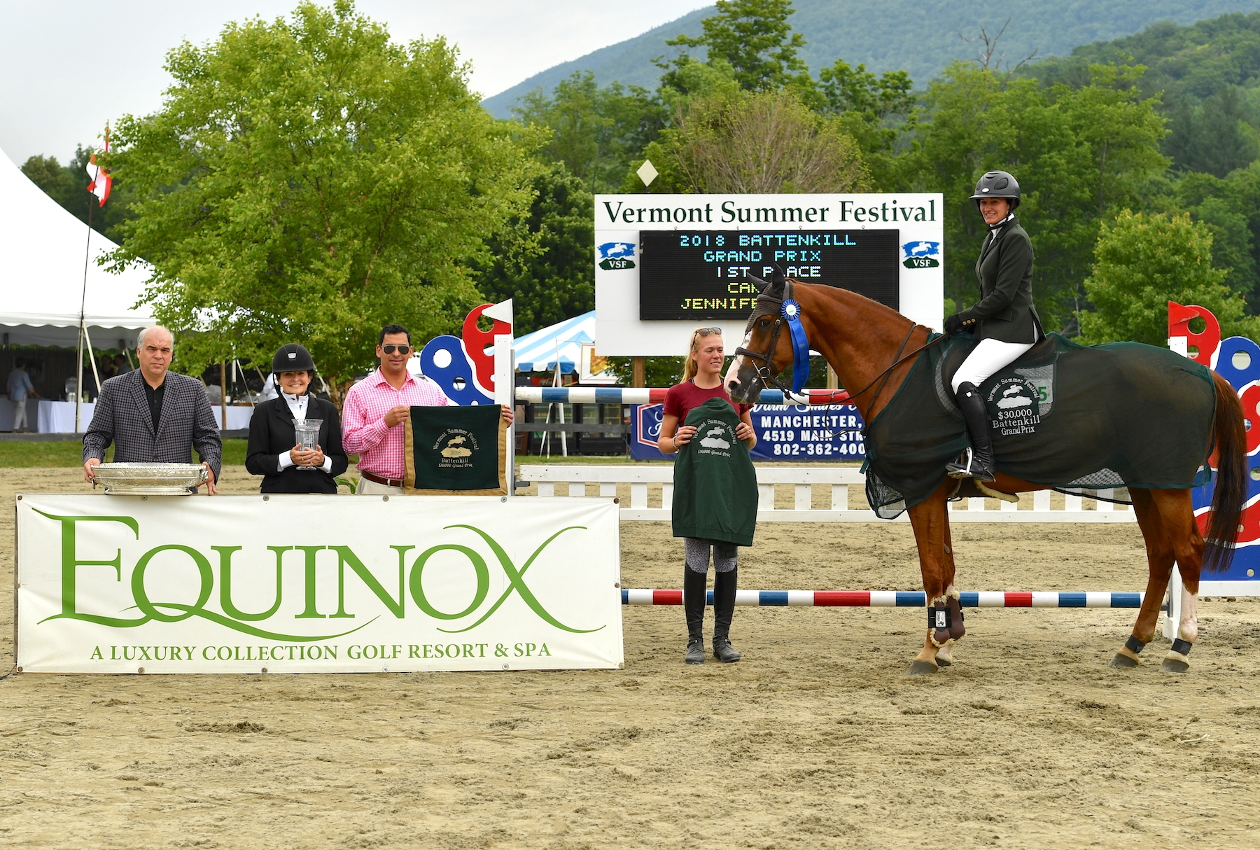 Jennifer Kocher and Carlos were presented as the winners of the $30,000 Battenkill Grand Prix, presented by The Equinox Resort, by representatives from The Equinox Resort, including (left to right) General Manager Roger Aberth, Spa Director Susan Wheeler, and Sales Manager Kenny Valenzuela, as well as groom Sara Zeerip at the Vermont Summer Festival on Saturday, July 14, in East Dorset, VT. <br><b>Photo by <a href='http://www.andrewryback.com/' target='_blank'>Andrew Ryback Photography</a></b>