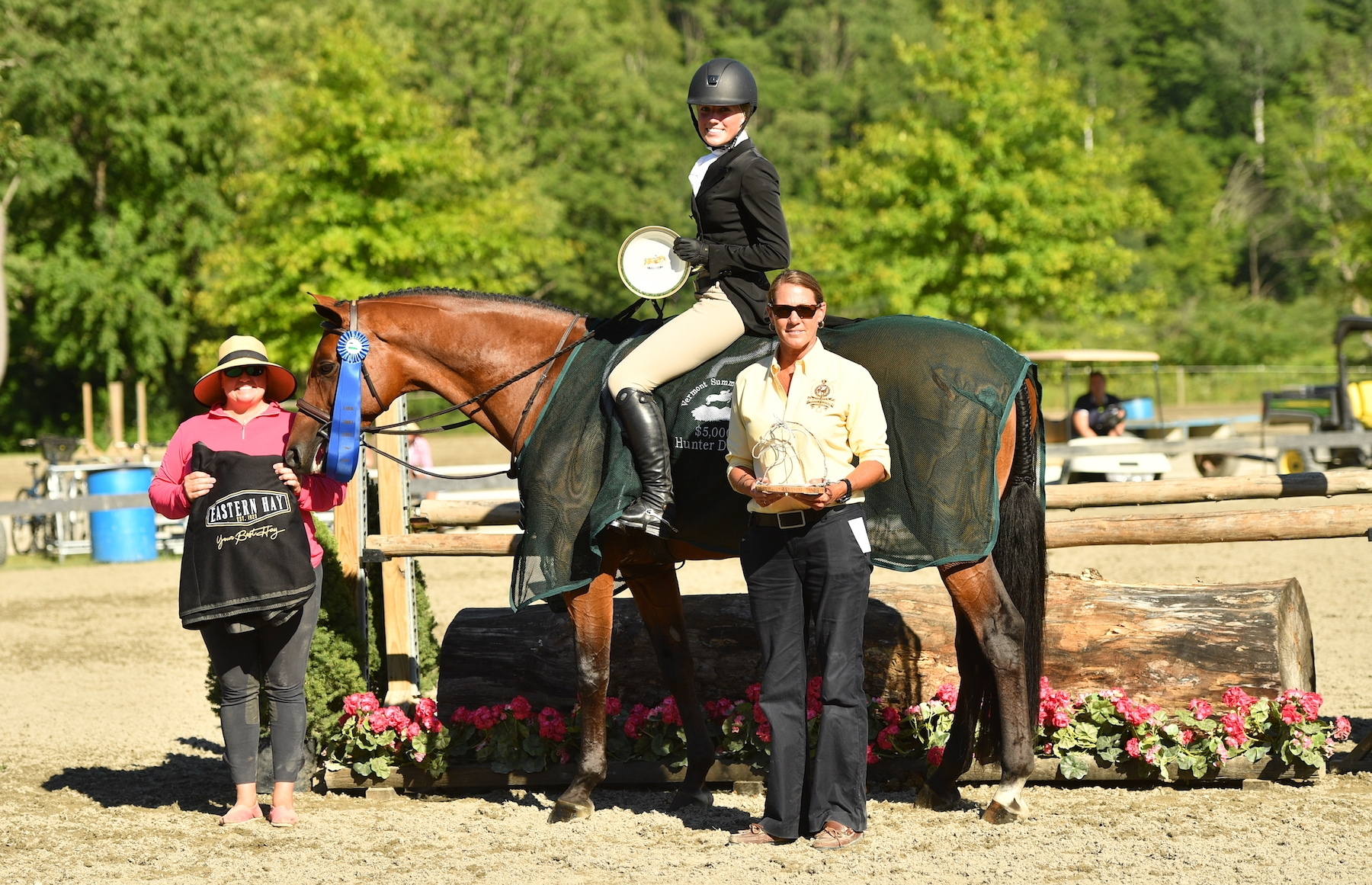 Katie McVeigh and Goyard, along with trainer Stephanie Demmon and Jennifer Glass of the Vermont Summer Festival, are presented as the winners of the $5,000 NEHJA Hunter Derby, presented by Eastern Hay, on Thursday, July 19, in East Dorset, VT.<br><b>Photo by <a href='http://www.andrewryback.com/' target='_blank'>Andrew Ryback Photography</a></b>