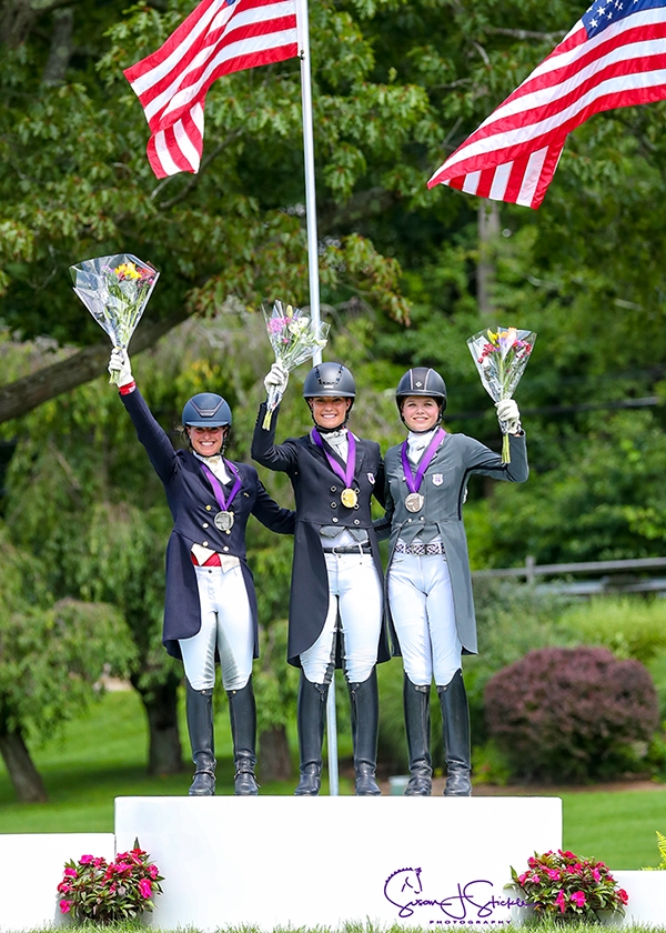 Young Rider individual medalists Beatrice Boucher (silver), Callie Jones (gold), and Kayla Kadlubek (bronze).<br><b>Photo by <a href='https://www.suestickle.com/' target='_blank'>SueStickle.com</a></b>