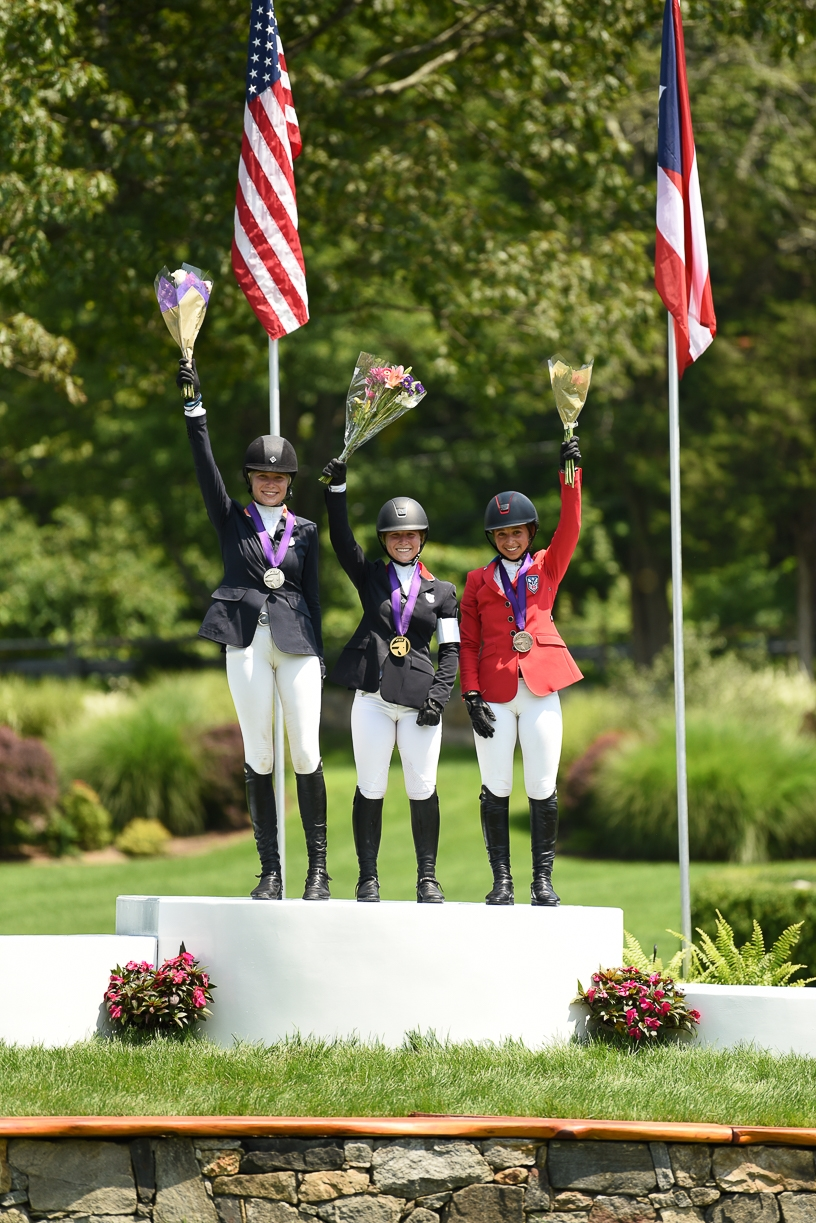 The final junior podium with Elli Yeager (silver), Alexandra Pielet (gold), and Claudia Villamil (bronze).<br><b>Photo by <a href='https://selphotography.com/' target='_blank'>SEL Photography</a></b>