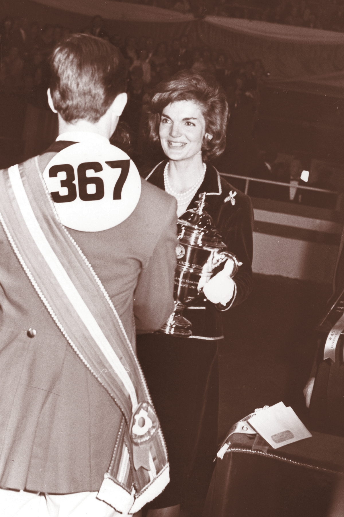 Jackie Kennedy presenting the President's Cup trophy, which she commissioned from Tiffany's, at the Washington International Horse Show.