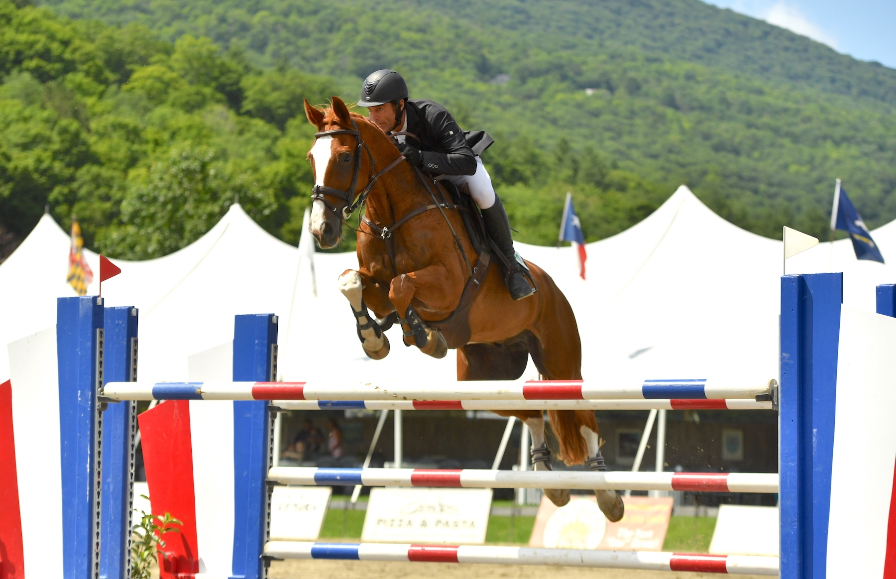 Kirk Webby won his second grand prix of the Vermont Summer Festival season in the $30,000 Battenkill Grand Prix, presented by Hampton Inn & Suites Manchester, riding Brando du Rouet on Saturday, July 13, in East Dorset, VT.<br><b>Photo by <a href='https://www.andrewryback.com/' target='_blank'>Andrew Ryback Photography</a></b>