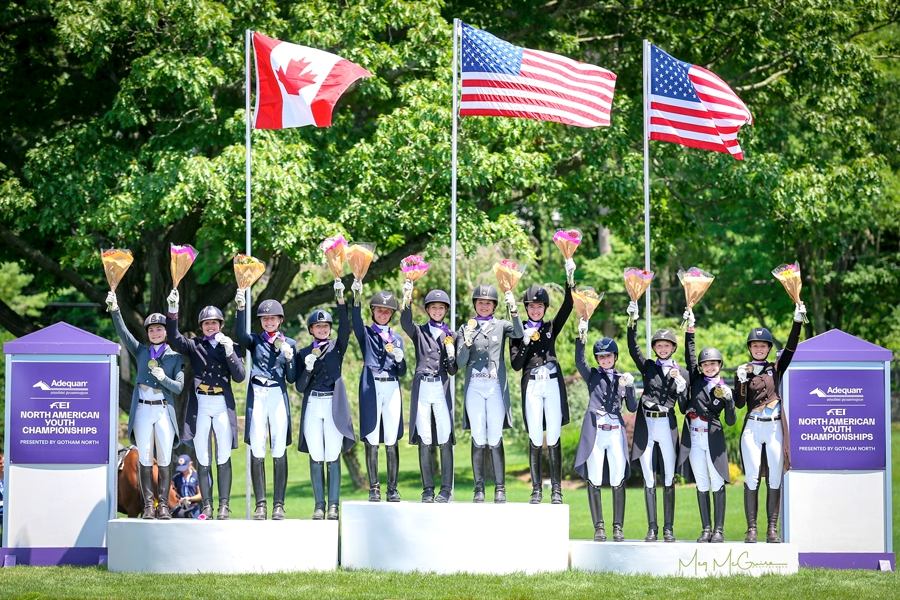 USDF North American Young Rider Dressage Team Championship podium finishers, Region 1 in with gold, Canadian Ontario/Quebec with silver, and Region 3 with bronze. <br><b>Photo by <a href='https://www.meg-mcguire.com/' target='_blank'>Meg McGuire</a></b>